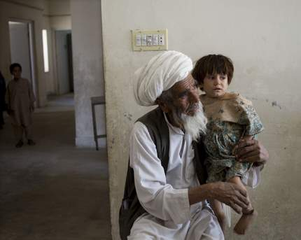 MSF: Afghan elder with child
