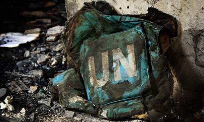 UN flag jacket in burnt Kabul guesthouse