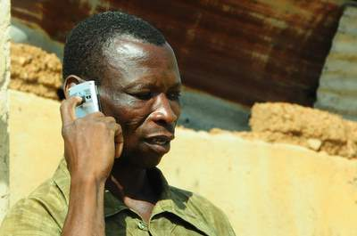 Farmer in Ghana with mobile phone