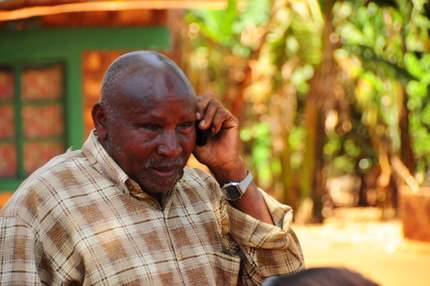 Kenyan farmer with mobile phone