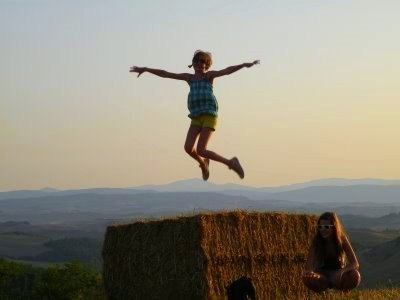 Child jumping in field